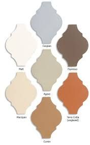 Image result for colour schemes to go with terracotta tiles and navy furniture
