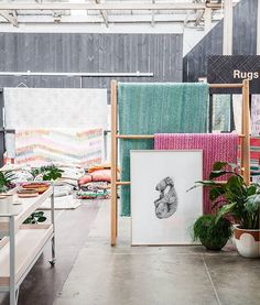 """Scenes from the #koskela showroom today:  Plush @Wearepampa Rugs Stunning @CarlalFletcher artwork Cheery @popandscott and @ontheside_ pots Practical & pretty @industriaxfurniture trolly Abundant @loomrugs folded in piles Textural @tjanpidesertweavers baskets Dainty @wingnutandco vessels  PS: Carla Fletcher's most popular prints """"The Alchemist"""" and """"Grey Kanga 1"""" now available for pre-order, just in time for Christmas entertaining. #ArchibaldPrizewinner Email info@koskela.com.au to secure…"""