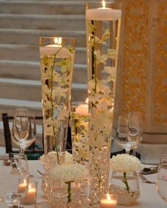 We like this without the flowers in the floating candle and the single flower in a vase with crystals.