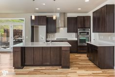 medium brown cabinets with white quartz countertop Basic Kitchen, Small Space Kitchen, Kitchen On A Budget, New Kitchen, Kitchen Decor, Kitchen Modern, Kitchen Ideas, Hickory Kitchen Cabinets, Espresso Kitchen Cabinets