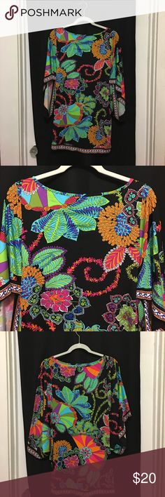 Trina Turk Swimsuit Cover-Up Fabulous Trina Turk Swimsuit Coverup Size Small. Gorgeous print colors of black/blue/green/orange /pink/purple/white. This will looks fabulous at the beach or pool. Made in the USA of imported fabric. 90% Nylon/10% Spandex. In good preowned condition. Please ask all questions prior to making an offer or purchase. Thanks for looking! Trina Turk Swim Coverups
