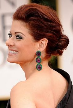 Sleek, back bangs, or deep part, with big earrings..