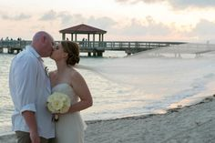 Beth and Chad at their destination wedding in Florida. Beth in a Nouvelle Amsale gown, exclusive to Nordstrom.