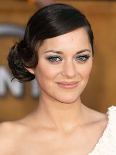 Marion Cotillard at the 2010 SAG Awards: http://beautyeditor.ca/gallery/top-10-beauty-looks-marion-cotillard/the-dark-knight-rises-european-premiere-2012/