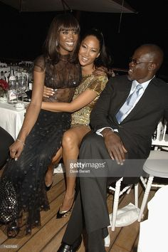 <a gi-track='captionPersonalityLinkClicked' href=/galleries/search?phrase=Naomi+Campbell&family=editorial&specificpeople=171722 ng-click='$event.stopPropagation()'>Naomi Campbell</a>, Kimora Lee Simmons and Djimon Hounsou attend the De Grisogono dinner held during the 60th International Cannes Film Festival at the Hotel du Cap, Eden Roc on May 22, 2007 in Cannes, France.