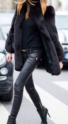 Skinny leather leggings, chunky zips and faux fur coat - all black