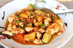 Sweet And Sour Chicken Or Tofu Recipe Main Dishes with chopped garlic, onion, sliced tomatoes, pineapple, spring onions, sliced cucumber, sliced chicken, cooking oil, fish sauce, oyster sauce, tomato sauce, sugar, water, salt