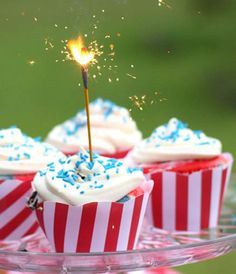 4th of July Sparkler Cupcakes    http://www.cupcakesgarden.com/4th-of-july-sparkler-cupcakes/