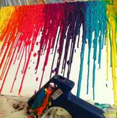 Crayons in the glue gun....i am so making art like this for my place next year