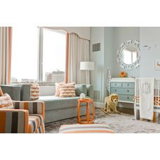 Nursery color palette - orange and grayed jade green.  Sofa in nursery