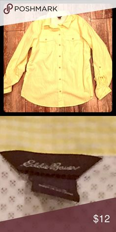 ⚜🆕WOT⚜ Eddie Bauer button up roll up sleeves NWOT Eddie Bauer sz S button up roll up with a button on sleeves. Material is light color is light yellow w white but mainly looks yellow. Has breathable openings on the sides. It's perfect for supper and out doors☀️ can't wait for summer🌞 Eddie Bauer Tops Button Down Shirts