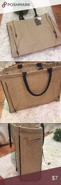 Chicos burlap bag This Chicos bag is new and perfect for carrying your beach towel or picnic. It is burlap but also has a shimmer to it. Chico's Bags Totes