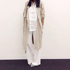 All white with  tan trench style jacket.
