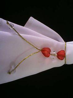 Porta guardanapo de coracao e cristal R$ 1,80
