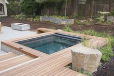 backyard hot tub with wood build