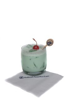 St. Patrick's Day Cocktail - Irish Sally -  1 oz Irish Whisky 0.25 oz Green Crème de Menthe 2 oz Cream Place ingredients in a shaker glass with Ice Shake well and pour into a rocks glass over ice. Garnish with a maraschino cherry.