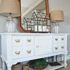 Check out how this card catalog entryway table was made from an old TV console.