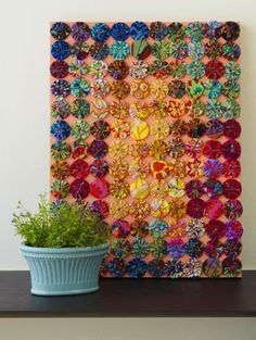 This display of yO-yo's is really coOL & I would have never thought that background color would compliment the color palette as well as it does.  I would love to create something like this to hang on one of my more bare walls. ♥