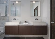 Modern cabinets, sink faucets, & basins.