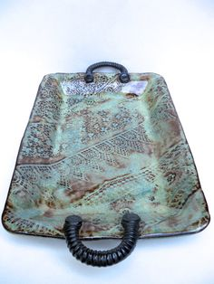 Hand-built stoneware tray with blue-green glazes, handles, and vintage lace impressions. $38.00, via Etsy.