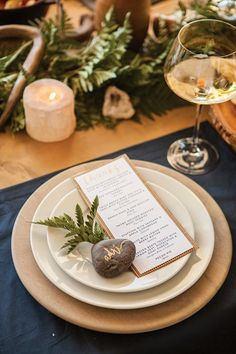 Rustic place setting — gold pen on a smooth stone