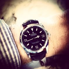 Rolex Explorer I with leather strap.
