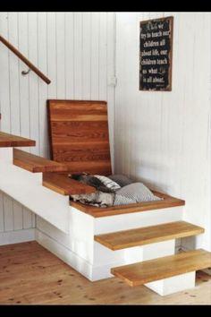 Hidden blanket storage under stairs??! Ahhhh.... More storage!
