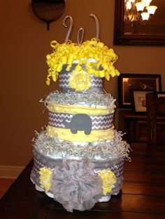 Elephant yellow and grey gender neutral diaper cake www.facebook.com/BayouBlingLA