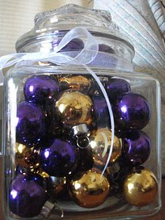 Purple and Gold Christmas Ornaments in a glass jar (my mom's last christmas was one of purple and gold decorations)