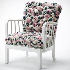 Modelno. BS0102.1/154, pastel roses. This chair is entirely made in Germany and manufactured completely by hand. It is upholstered of over 260 handmade pompons in pastel rose- design. These are made from merino wool and merino wool mixture. Measure is: seating hight 42-43cm, seating depth 45cm, hight of backrest 82cm, width 64cm.Total weight is about 22kg. This object is a unique one made out of a vintage chair.