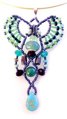 """""""Innamorramento - Forest Mist"""" Pendant. Green Aventurine, Green Jade, Turquoise, Freshwater Pearl, Magnetite, Green Dyed Marble and Swarovski Crystals. $180.00"""