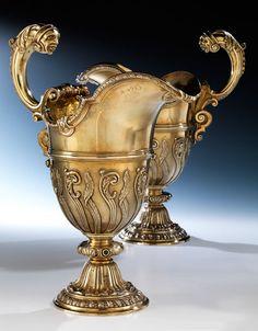 Pair of English silver-gilt helmet pitchers, Robert Garrard, London 1873.