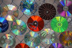 gorgeous and bright - painted cd's to decorate our fence