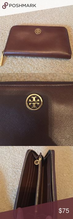Tory Burch Robinson zip around wallet Authentic brown Tory burch zip around wallet. Gently used price reflects. 8 card slots great condition inside Tory Burch Bags Wallets