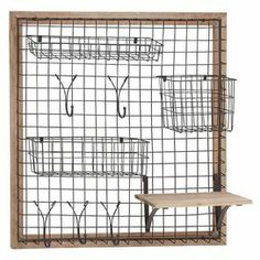 "Add versatile appeal to your entryway or master suite with this wire and wood wall rack, showcasing an array of bins and hooks for stowing scarves, keys, or jewelry.  Product: Wall rackConstruction Material: Iron and woodColor: BrownFeatures:  Three basketsFive hooksOne shelf Dimensions: 28"" H x 28"" W x 8"" D"