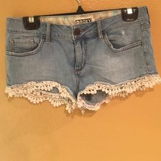 Rosy Shorts with Lace Trim Rosy Shorts with Lace Trim. Worn twice. Too small for me. Say size 5. Roxy Shorts Jean Shorts