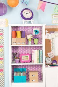 For an extra pop of color, line the back of your classroom bookshelves with brightly colored paper!