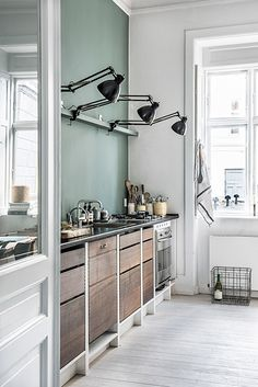 copenhagen home with modern kitchen and black clip-on light fixtures / sfgirlbybay
