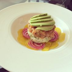 Salmon tartare, shaved fennel salad, taziki, avocado with raw and pickled mandolined beet slices.