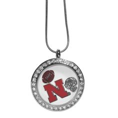 """Checkout our #LicensedGear products FREE SHIPPING + 10% OFF Coupon Code """"Official"""" Nebraska Cornhuskers Locket Necklace - Officially licensed College product 18 inch snake chain with 2 inch extender High-polish locket surrounded by crystals Magnetic closure allows you to easily add charms to create your own treasure locket Comes with 3 charms; football, helmet and Nebraska Cornhuskers charm - Price: $20.00. Buy now at…"""