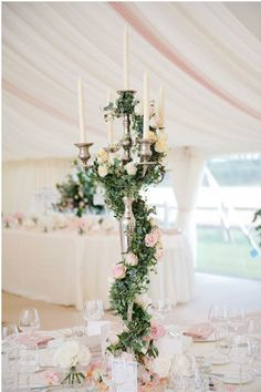 Garden Wedding Centerpiece Inspiration | Place a tall candelabra in the middle of your reception table with cascading greenery and candlesticks. The garden roses add a final romantic touch.