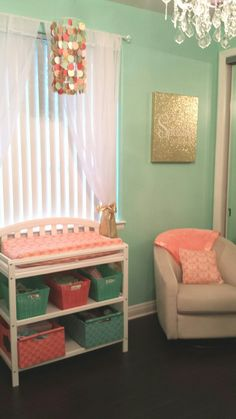 Coral, mint, gold babygirl nursery