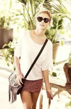 Love everything about this look. Mini skirt. Fringed bag. Fun sunnies.