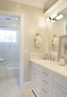 white cabinet, crema marble, subway tile