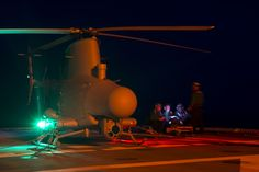 """SOUTH CHINA SEA (April 30, 2017) Sailors assigned to the """"Wildcards"""" of Helicopter Sea Combat Squadron 23 run tests on the MQ-8B Firescout unmanned aerial vehicle aboard the littoral combat ship USS Coronado (LCS 4). The ship is on a rotational deployment in U.S. 7th Fleet area of responsibility, patrolling the region's littorals and working hull-to-hull with partner navies"""