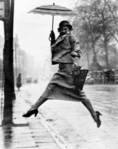 Fashion Photography by Martin Munkacsi: The Puddle Jumper - Lady with umbrella, circa 1934