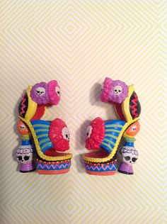 Skelita Calaveras repainted doll shoes - these are so cool. The shoes have lots of little details, but almost all of it is just painted black, so you don't see it. But here all of the details are highlighted in all kinds of colors. I'm going to do this with my dolls' shoes