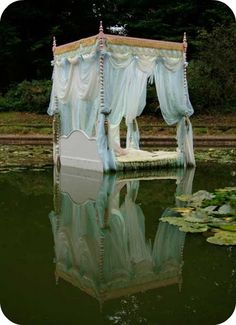 Floating in the water in a canopy bed so romantic