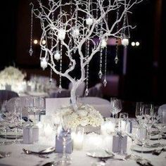 Faux Manzanita branch (White)- How stunning is this faux manzanita branch as a winter wedding centerpiece? Painted in white with added ornaments, it creates the perfect winter wonderland style. Winter Wedding Receptions, Winter Wedding Centerpieces, Wedding Reception Planning, Wedding Table, Wedding Day, Wedding Tips, Dream Wedding, Winter Weddings, Manzanita Wedding