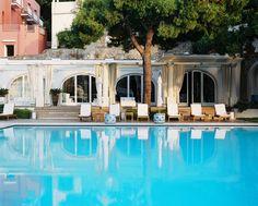 Chaises and umbrellas surrounding a pool; J.K. Place, Capri